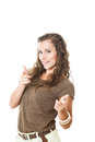 Young female pointing at you with two forefingers isolated on white Royalty Free Stock Photos
