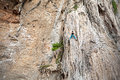 Young female rock climber on incredible wall railay beach in thailand Royalty Free Stock Images