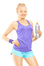 Young female in running outfit posing with a drink bottle isolated on white background Stock Images