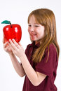Young female school child uniform polo shirt holding clear plastic apple Royalty Free Stock Photo