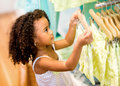 Young female shopper at a retail store looking for clothes Royalty Free Stock Photos