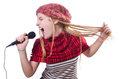 Young female singer with mic on white Stock Images