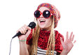Young female singer with mic on white Royalty Free Stock Photos