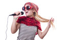 Young female singer with mic on white Royalty Free Stock Image