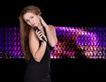 Young female singer portrait of beautiful woman singing in microphone Stock Photography
