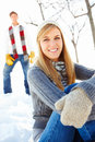 Young female sitting outside on snow Stock Images
