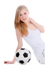 Young female sitting with soccer ball over white Royalty Free Stock Photography
