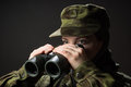 Young female soldier observe with binoculars war military army people concept portrait of unarmed woman camouflage Stock Photos
