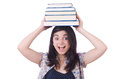 Young female student with books on white Stock Photography