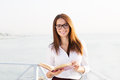 Young female student  in reading glasses with the book Royalty Free Stock Photo