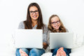 Young female students relaxing with laptops. Royalty Free Stock Photo