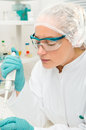 Young female tech or scientist works in the lab Royalty Free Stock Images