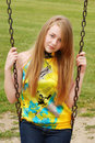 Young female teenager on a swing Royalty Free Stock Images