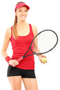 A young female tennis player holding a racket and ball Stock Photos