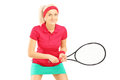 Young female tennis player holding a racket isolated on white background Stock Photo