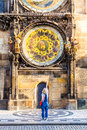 Young female traveler refers to the astronomical clock in the Old Town Hall. Prague