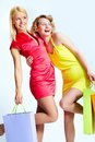 Young females with shopping bags over white background Royalty Free Stock Photo