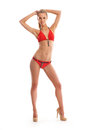 A young and fit blond woman in a red swimsuit Royalty Free Stock Photography
