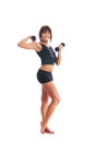 A young and fit brunette woman holding dumbbells Royalty Free Stock Photo