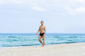 Young, fit handsome man on a summer beach Royalty Free Stock Photo