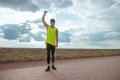 Young fit man resistance band outdoors training arm up Royalty Free Stock Photo