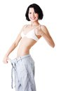Young fit woman with big pants Royalty Free Stock Photos