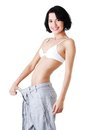 Young fit woman with big pants Stock Photo