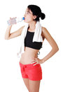 Young fit woman drinking mineral water Royalty Free Stock Photo