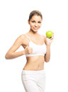 A young and fit woman holding a green apple sporty beautiful girl with the isolated on white Stock Images