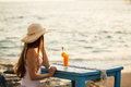 Young fit woman in summer outfit seating on wooden blue chair bu Royalty Free Stock Photo