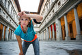 Young fitness female is catching breathe next to Uffizi gallery Royalty Free Stock Photo