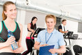 Young fitness instructor gym people exercise Royalty Free Stock Photos