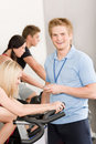 Young fitness instructor gym people spinning Royalty Free Stock Photo