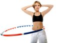 Young fitness woman with hula hoop isolated sporty girl doing exercise on white Royalty Free Stock Photos