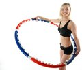 Young fitness woman with hula hoop isolated sporty girl doing exercise on white Stock Photos