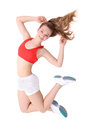 Young fitness woman jumping over white Royalty Free Stock Photo