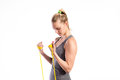 Young fitness woman with rubber bands. Studio shot.