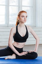 Young fitness woman sitting in yoga position Royalty Free Stock Photo