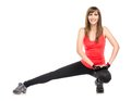 Young fitness woman stretching legs Royalty Free Stock Photo