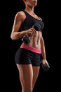 Young fitness woman in training pumping up muscles with dumbbell Royalty Free Stock Photo