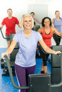 Young fitness woman at treadmill running class Stock Photos