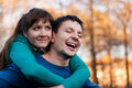 Young flying couple in park portrait of women and men the autumn Royalty Free Stock Image