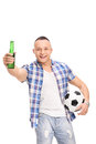 Young football fan holding a beer and cheering vertical shot of looking at the camera isolated on white background Stock Photo