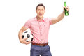 Young football fan holding a bottle of beer studio shot and cheering isolated on white background Royalty Free Stock Image