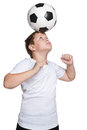 Young footballer a portrait of dexterous with a ball on the white background Stock Image