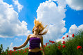 Young free happy woman in poppy field Stock Image