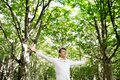Young free man enjoying nature freedom happines concept in a forest Stock Images