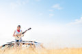 Young free musician woman outdoor on blue sky. Royalty Free Stock Photography