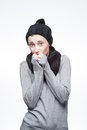 Young freezing girl on gray Royalty Free Stock Photography