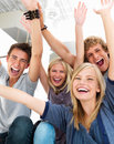 Young friends with arms raised in success Stock Photo